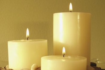 Turn a plain pillar candle into a wedding unity candle with Mod Podge.