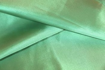 The iridescent sheen of silk fabric lends an upscale look to curtains.