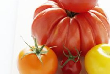 Ripe tomatoes are usually red but can be orange or yellow.