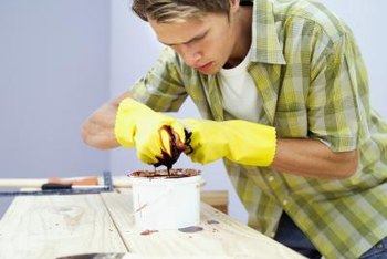 Stain or paint over whitewash with proper preparation.