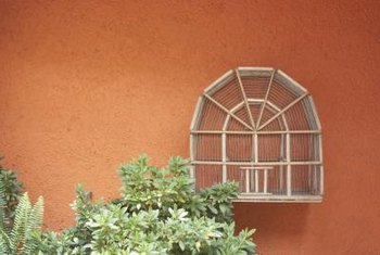 Mount a bird cage on an outside wall and fill it with plants.