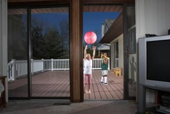 Keep a screen door's tracks clean to minimize roller wear.