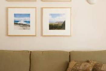 Professional advice can guide the placement of picture groupings above the couch.