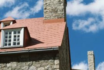 The proper method of channeling water away from a chimney is to use flashing around the base.