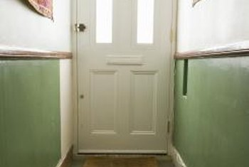 A light-colored door enhances a closed, narrow space with a dark floor.