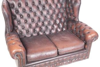 Fix damage to your leather loveseat with the right tools and materials.
