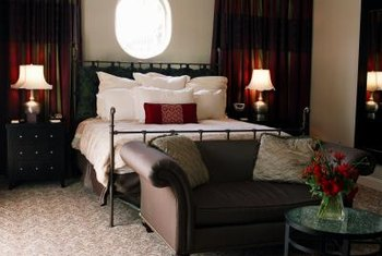 A Loveseat At The Foot Of The Bed Creates A Neat Arrangement.