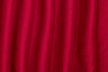 Wrinkle-free silk curtains drape elegantly over a window.