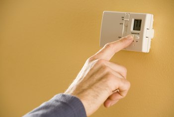A programmable thermostat automatically raises or lowers the termperature.