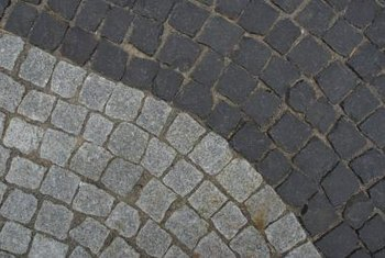 Maintaining pavers primarily involves cleaning stains and repairing damage as it occurs.