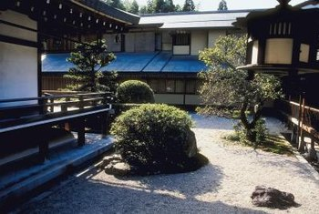 A low shrub or shaped tree complements a Zen garden.