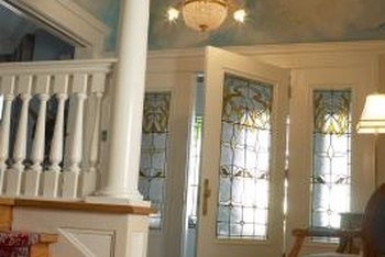 Foyer doors often frame glass windows with hand-crafted details.