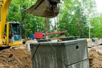 Septic tanks hold liquid and solid waste from your home's plumbing.