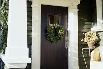 A front door can match the colors in walkway stone.