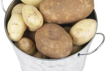 Mulching potatoes can help increase yield by keeping weeds and pests away and adding nutrients to the soil.