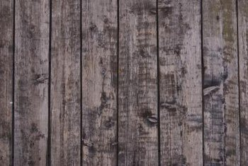Old wooden fences can mildew and warp from water damage.