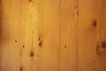 You can brighten pine walls by sanding off the stain.