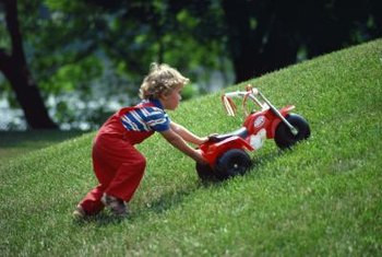 Turf grass isn't the best choice for a slope but can be fun for kids.