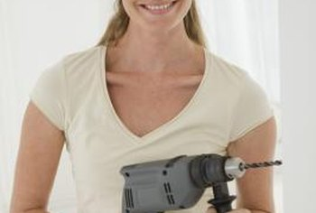 An accessory handle on the drill adds control when drilling holes.