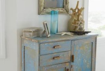 Even if the surface is already worn, vintage painted cabinets should be carefully cleaned to avoid damage.