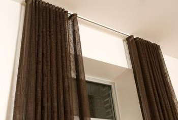 Using ceiling-hung curtains saves holes in walls and makes a dramatic statement.