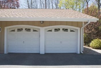 You can upgrade garage door windows with designer windows.