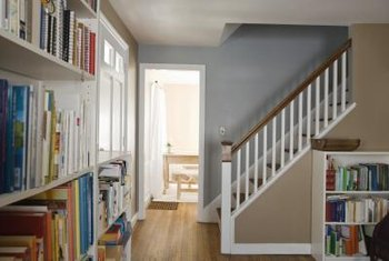 Prefab bookcases can be trimmed with various moldings to make them look like built-ins.