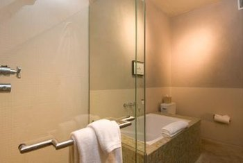Frameless shower doors blend into the decor of a bathroom.