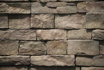 Stones of different sizes or shapes create a natural-looking wall.
