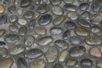 Loose stone paths can create a walking hazard, but pebble pavers are more secure.