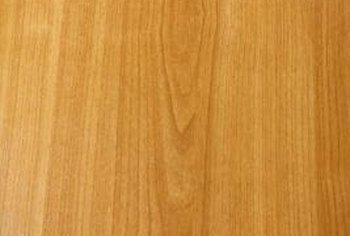 Use golden tan and ruddy brown stains to simulate the look of oak.