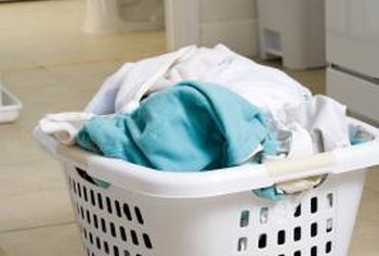 Dedicate a part of the bathroom to laundry.