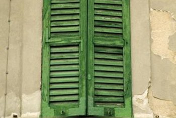 Distressing shutters gives them a rough, aged look.