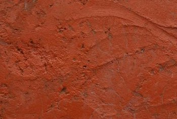 Create visual interest by adding texture to terra-cotta painted walls.