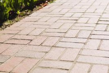 How to Build Paver Walkways With Restraint Borders | Home