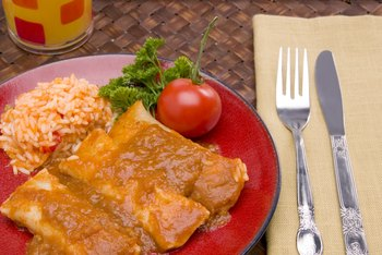 Corn tortillas are the biggest source of carbs in chicken enchiladas.