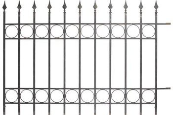 Decorative elements, such as circles or loops, can be added to a basic ornamental aluminum fence.