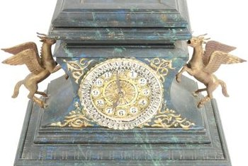 Black marble, sculpted mythological figures and ornate trim adorn French clocks.