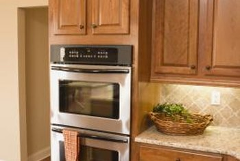 Painting kitchen cabinets can give the room an entirely new look for little cost.