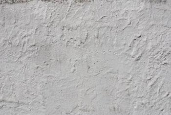 Use Polycell SmoothOver to get rid of stucco.