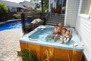 Use clear or tinted resin that matches the color of the fiberglass hot tub.