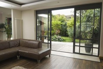 Tinted sliding glass doors provide privacy and protection from the sun.