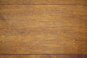 A thorough sanding removes most stains from wood flooring.