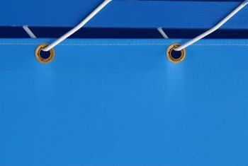 A tarp usually includes grommet holes for attaching rope.