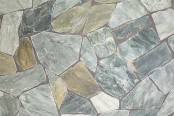 Irregularly shaped stone fits together to pave a patio or walkway.