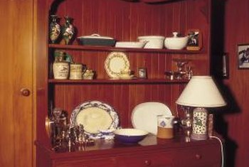 An antique shelf makes a perfect backdrop for antique collectibles.