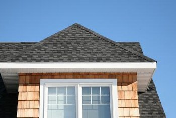 Repairing the ridges of an asphalt roof requires specialized shingles.