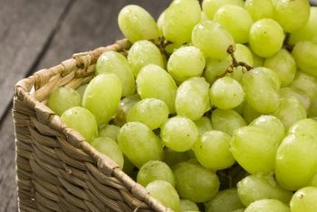Test if grapes are ripe by tasting them.