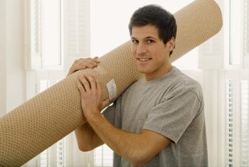 Install rolls of old carpet to add cushion and insulate a cold floor.