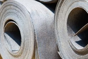 Asphalt felt flooring underlayment comes in large rolls, and the material tears somewhat easily.